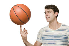 Basket ball on finger of man Royalty Free Stock Photo