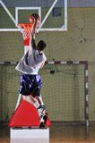 Basket ball game player at sport hall Stock Photos