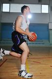 Basket ball game player at sport hall Royalty Free Stock Photo