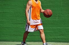 Basket ball in hand Royalty Free Stock Images