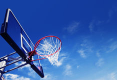Basket ball hoop. Basket ball net and hoop with dramatic blue sky Royalty Free Stock Photos