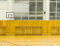 Basket ball hoop on the wall.  The school sporting hall. Basketball hoop on the wall.  Empty basketball court. The school sporting hall Stock Photo