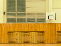 Basket ball hoop on the wall.  The school sporting hall. Basketball hoop on the wall.  Empty basketball court. The school sporting hall Stock Photos