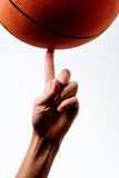 Basket ball spinning. On a finger Royalty Free Stock Image