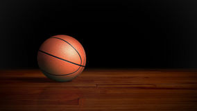 Basket-ball sur le plancher en bois 2 Photos stock