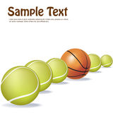 Basket ball in between tennis balls Stock Image