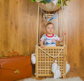 In the basket of the balloon in flight plays the boy child Royalty Free Stock Image