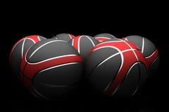 Basket-balls d'isolement sur le fond noir images libres de droits