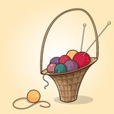 The basket with balls of yarn. Cartoon illustration of the basket with yarn balls of different colors Stock Image