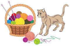 Basket with balls of yarn and cat Royalty Free Stock Image