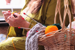 Basket with balls of yarn  and woman knitting Royalty Free Stock Photo