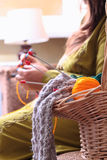 Basket with balls of yarn  and woman knitting Royalty Free Stock Images