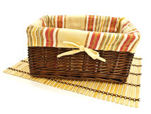 Basket at bamboo mat Stock Photos