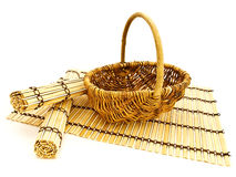 Basket and bamboo mats Royalty Free Stock Images