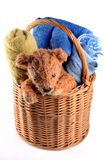 Basket with bath towels and a teddy bear royalty free stock photo