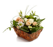 Basket with beautiful flowers isolated Royalty Free Stock Photo