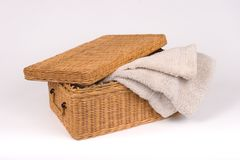 Basket of Beige towels_8119-1S. Retangular Basket of Beige Towels with Cover Stock Image