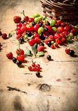 Basket with berries. On wooden table. Stock Photo