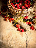 Basket with berries. On wooden table. Stock Photos