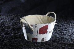 Basket on a black rug Stock Photo