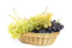 Basket of black and white grapes Royalty Free Stock Images