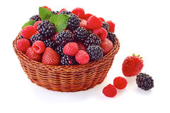 Basket with blackberries, strawberries and raspberries on white. Basket with blackberries, strawberries and raspberries  on white background Royalty Free Stock Images