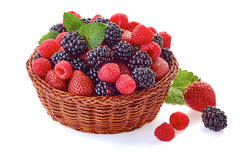 Basket with blackberries, strawberries and raspberries on white. Basket with blackberries, strawberries and raspberries  on white background Royalty Free Stock Photos