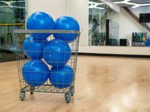 Basket with blue core exercise balls in an exercise studio with mirror. Basket filled with blue core exercise balls in an exercise studio with mirror stock photo