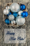 In a basket of blue and silver Christmas balls and beads, and pl Royalty Free Stock Image