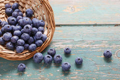Basket of blueberries on a turquoise wooden table Stock Photos