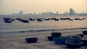 Basket boats against new town of Da Nang royalty free stock photography