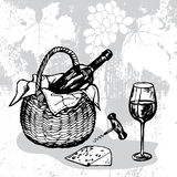 Basket with bottle of wine, wineglass, cheese and corkscrew Royalty Free Stock Photo