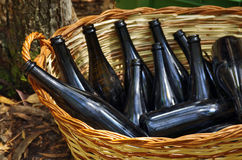 Basket with Bottles Stock Images