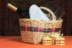 Basket with bottles and glasses. A basket with bottles and glasses Composition royalty free stock photography