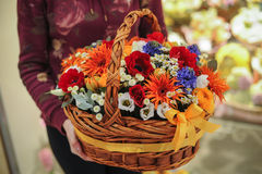 Basket with a bouquet of colorful flowers Royalty Free Stock Image
