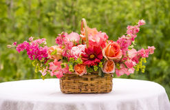 Basket Bouquet with  Roses, Gaillardia, Sweet Peas, Llarkspur, B Royalty Free Stock Photos