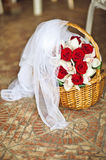 Basket, bouquet of roses and veil bride Stock Images