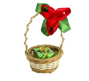 Basket with a bow and a gift. On the white isolated background Stock Photography