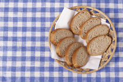 Basket with bread. Basket with round of bread Stock Images
