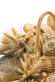 Basket with a bread assortment isolated on white Stock Photos