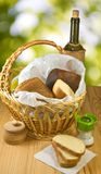 Basket with bread and a bottle of wine Royalty Free Stock Photography