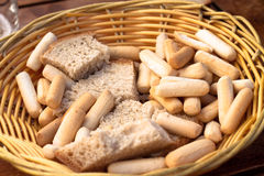 Basket with bread and bread sticks Stock Images