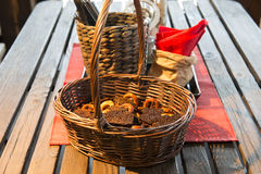 Basket with bread and drying on the  table Stock Images