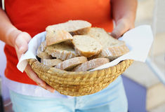 Basket of bread in hands Stock Photos