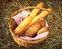 Basket of bread and milk. Basket of bread in a haystack stock photography