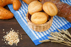 Basket with bread products on the tablecloth and oat groats Royalty Free Stock Images