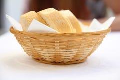 Basket of bread in restaurant Stock Photo