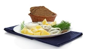 Basket with bread and snack. Basket with bread and a dish with snack on the blue napkin, isolated on white Royalty Free Stock Photo