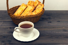 Basket with bread sticks, white porcelain cup and saucer Royalty Free Stock Photos