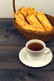 Basket with bread sticks, white porcelain cup Royalty Free Stock Image